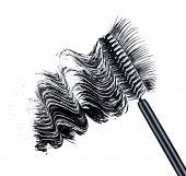 Smear Of Black Brush Mascara And False Eyelashes Isolated On White Background