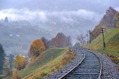 metal railway in autumn time