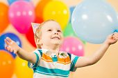 Joyful Kid Boy With Balloons On Birthday Party