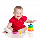 Baby Girl Playing With Colourful Toy Isolated On White Background
