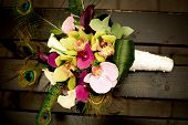 Colorful wedding bouquet with peacock feathers �?�¼ vintage photo