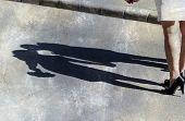 Shadow of kissing couple