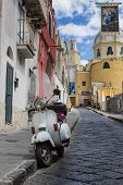 picture of vespa  - view of an alley on the island of Procida with the flag of the Virgin Mary and a wasp - JPG