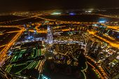 DUBAI, UAE - 1 APRIL 2014: Panorama of city centre in Dubai at night, UAE. View from the 124 floor o