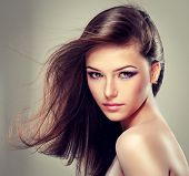 foto of lipstick  - Brunette beautiful girl with long hair  - JPG