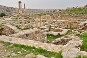 AMMAN, JORDAN - MARCH 17, 2014: Ruins of the Byzantine Church and the Temple of Hercules on the Citadel hill. The ruins on the hill today are Roman through early Islamic