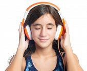 Beautiful hispanic teenage girl enjoying music on bright orange headphones with her eyes closed