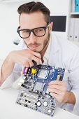 Computer engineer working on broken cpu in his office