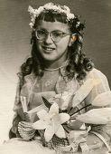 SIERADZ, POLAND - CIRCA 1950 - Vintage photo of little girl at her First Communion.