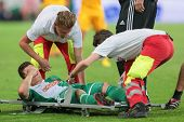 VIENNA, AUSTRIA - AUGUST 8 Marcel Sabitzer (#24 Rapid) is hurt during the UEFA Europa League game on