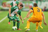 VIENNA, AUSTRIA - AUGUST 8 Christos Pipinis (#3 Asteras) and Marcel Sabitzer (#24 Rapid) fight for t