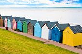 stock photo of herne bay beach  - Colorful diagonal line of beach huts in England - JPG