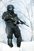 pic of m4  - NATO soldier in winter uniform with the M4 machine gun on the forest background - JPG