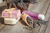 Natural Handmade Lavender Oil And Soap And Fresh Lavender Flowers On Wooden Background