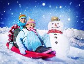 Little Girl and Boy Outdoors Sleding and Snowman