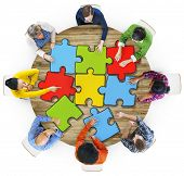 Multiethnic Group of People with Jigsaw Puzzle in Photo and illustration