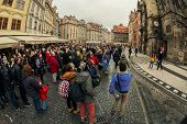 Tourists watch astronomical clock in Prague
