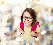 education and school concept - happy and smiling teenage girl in eyeglasses with bag