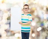 vision, health, advertisement, holidays and people concept - smiling little boy wearing eyeglasses w