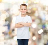 advertising, holidays, party, people and childhood concept - smiling little boy in white blank t-shi