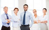 business, office and people concept - group of smiling businessmen in office