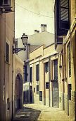 Vintage photo of narrow street in old city of Palma de Mallorca, Spain
