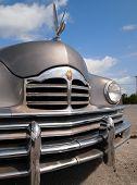Vintage Packard Car With Swan