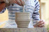 Children Potter's hands creating new cup
