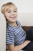 Portrait of cute boy relaxing on sofa