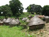 picture of mud-hut  - A village of mud huts with thatch roofs is typical of African rural architecture - JPG