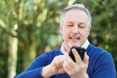 Portrait of a mature man using a cell phone