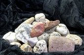 pic of mica  - Pyramid from multicolored stones on black velvet - JPG