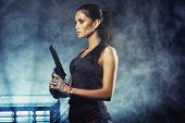 pic of raider  - sexy brutal woman standing on factory ruins and holding handgun - JPG