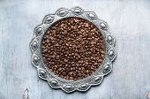 Coffee Beans In Silver Vintage Plate On Wooden Background