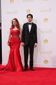 LOS ANGELES - AUG 25:  Christina Hendricks, Geoffrey Arend at the 2014 Primetime Emmy Awards - Arrivals at Nokia Theater at LA Live on August 25, 2014 in Los Angeles, CA