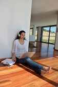 beautiful young woman relax and work on laptop computer while working on laptop computer and read bo