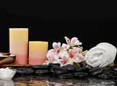 spa concept orchid and ,candle, towel, salt in bowl,stones