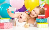 Happy Children's Birthday. Selfie. Mother Photographed  Her Daughter The Birthday Child With Balloon