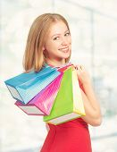 Happy Woman With Bag On A Shopping In The Mall