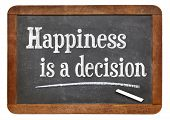 happiness is a decision - motivational phrase on a vintage slate blackboard