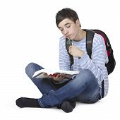 Young Handsome Male Student Learining With Study Book
