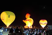 KIBBUTZ BEERY, ISRAEL - FEBRUARY 25, 2012: Three huge balloons. glowing balloons in the night sky