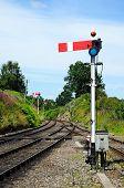 Railway semaphone signal alongside railway track.