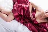 Sensual Woman Lying In Red Bedding