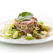 Beef Tongue Salad with Ham, Eggs, Vegetables and Nuts. Garnished with Basil Leaf