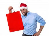 Happy Young Handsome Man Wearing Santa Hat Holding Red Shopping Bag