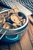 the dried shiitake mushrooms in colander