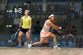 AUGUST 19, 2014 - KUALA LUMPUR, MALAYSIA: Nicol David of Malaysia (front) hits a back-hand return in her match against Liu Tsz-Ling of Hong Kong in the CIMB Malaysian Open Squash Championship 2014.