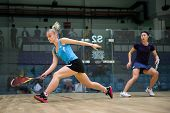 AUGUST 19, 2014 - KUALA LUMPUR, MALAYSIA: Emily Whitlock (blue) hits a return at front court while playing Joey Chan in the CIMB Malaysian Open Squash Championship 2014.