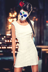 stock photo of day dead skull  - Day of the dead girl with sugar skull makeup - JPG